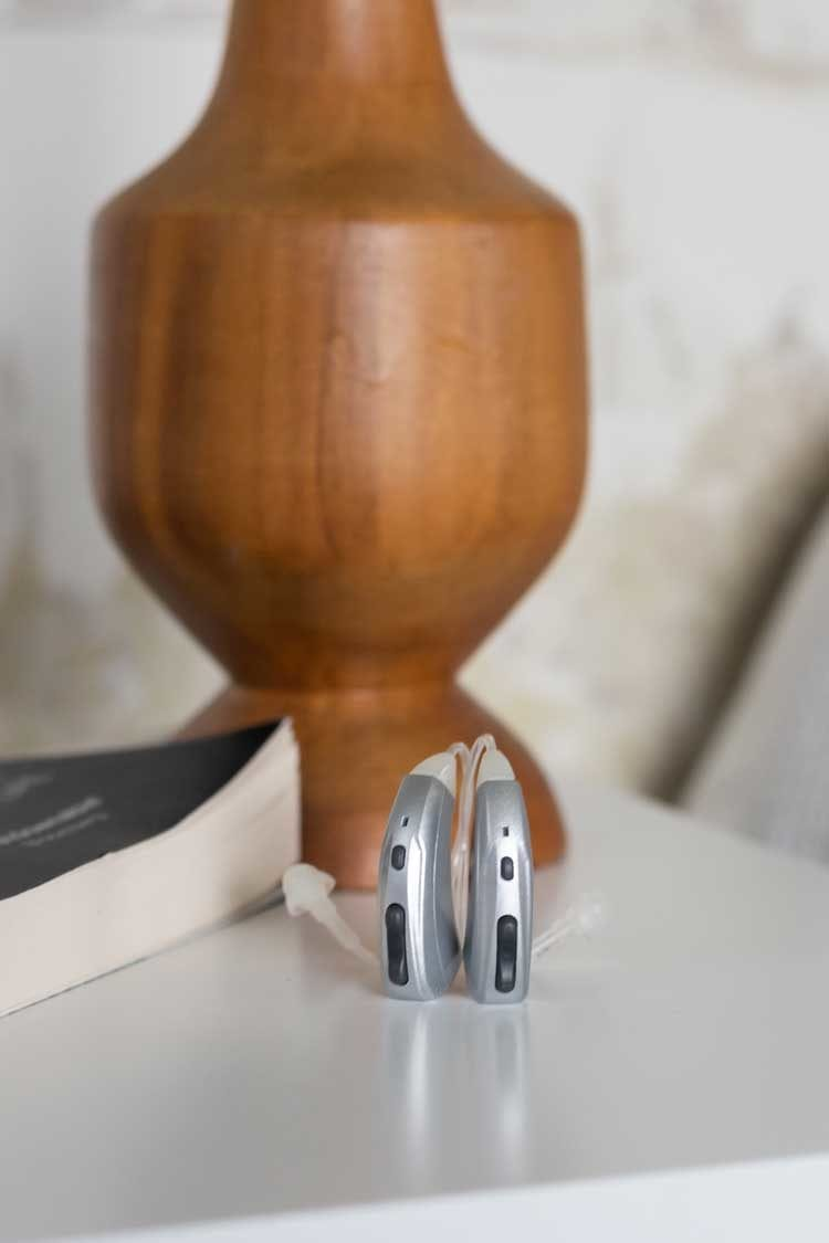 2 Evok hearing aids on bedside table