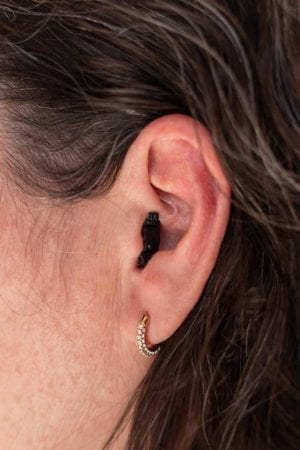 Almost invisible Ole 2 hearing aid in ear