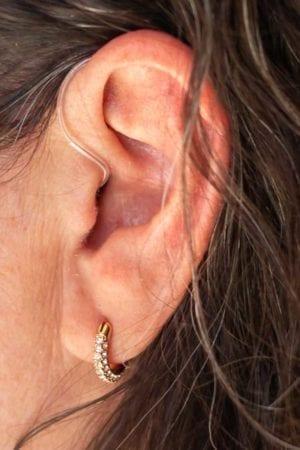 Opa 300 behind the ear hearing aid in ear