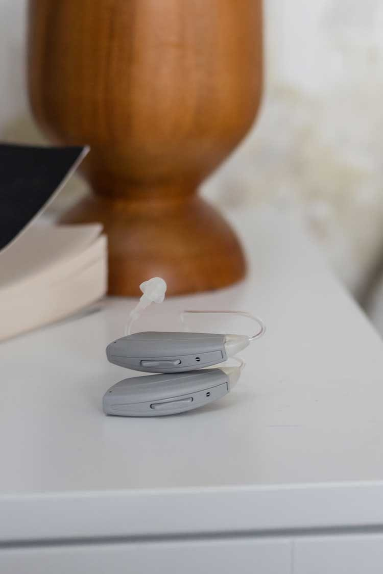 Rx hearing aids on bedside table